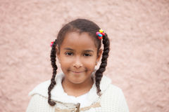 Beautiful african child with a brick a pink wall Royalty Free Stock Photography