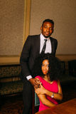 Beautiful african couple posing in the luxurious apartments.  stock image