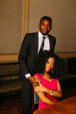 Beautiful african couple posing in the luxurious apartments.  royalty free stock photography