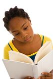 Beautiful African descent young lady reading book Stock Photography