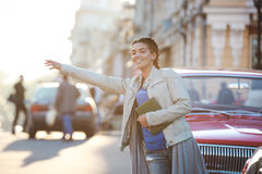 Beautiful african girl catching the car Stock Photography
