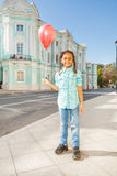 Beautiful African girl with flying balloon in city Royalty Free Stock Photos
