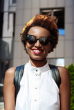Beautiful african girl smiling walking down city. Fashion street style. Royalty Free Stock Image