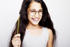 A beautiful African kid girl in glasses holding pencil in hand. A beautiful African kid girl in glasses holding pencil stock images