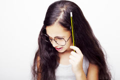 A beautiful African kid girl in glasses holding pencil in hand. Beautiful African kid girl in glasses holding pencil in hand Royalty Free Stock Images
