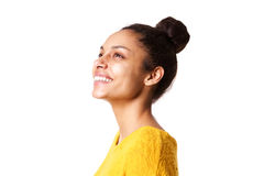 Beautiful african lady looking away and smiling. Close up portrait of beautiful african lady looking away and smiling on white background Royalty Free Stock Photography