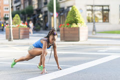 Beautiful african sport woman ready to run on the street. Stock Photos