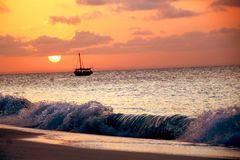 A beautiful African sunset with a dhow royalty free stock image