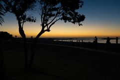 Beautiful African sunset over boulevard of Camps Bay stock photography
