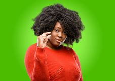 Beautiful african woman with curly hair isolated over green background stock images