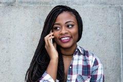 Beautiful african woman flirting at phone Royalty Free Stock Photo