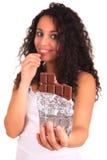 Beautiful african woman holding chocolate bar Royalty Free Stock Photos