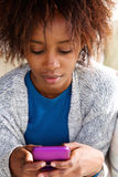 Beautiful african woman holding mobile phone Royalty Free Stock Photos