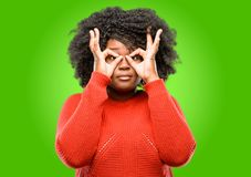 Beautiful african woman with curly hair isolated over green background Royalty Free Stock Photo