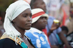 Beautiful african girl. Nampula, Mozambique - November 10, 2014: Young beautiful  woman wearing traditional scarf attends a public event in Northern Mozambique Royalty Free Stock Photography