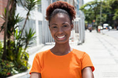 Beautiful african woman in a orange shirt Royalty Free Stock Photo