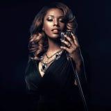 Beautiful African woman singing stock image