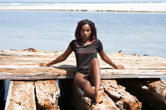 Beautiful African Woman Sitting On The Beach Royalty Free Stock Image