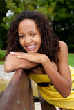Beautiful african  woman sitting on a bench Stock Photography