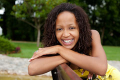 Beautiful african woman sitting on a bench Stock Images