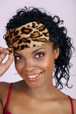 Beautiful African woman in sleeping mask Stock Image