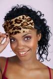 Beautiful African woman in sleeping mask stock image
