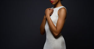 Free Beautiful African Woman Standing In An Elegant White Gown Royalty Free Stock Photo - 47558905