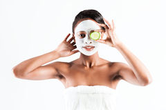 Beautiful African woman in Studio with facial mask Stock Image
