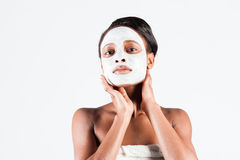 Beautiful African woman in Studio with facial mask Stock Photo