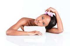 Beautiful African woman in Studio with towel Royalty Free Stock Photos