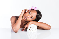 Beautiful African woman in Studio with towel Royalty Free Stock Image