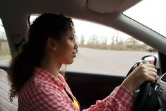 Beautiful african woman taking driving test stock photography