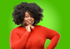 Beautiful african woman with curly hair isolated over green background royalty free stock photography