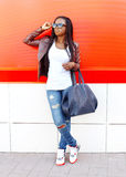 Beautiful african woman wearing a leather jacket and sunglasses Royalty Free Stock Image