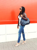 Beautiful african woman wearing a leather jacket and sunglasses Royalty Free Stock Images
