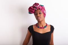 Beautiful african woman wearing a traditional headscarf Stock Images