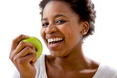 Beautiful African women eating an apple stock photos