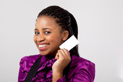 Beautiful African women holding a blank business c royalty free stock images