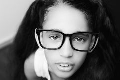 A beautiful African young girl wearing glasses. Stock Photography
