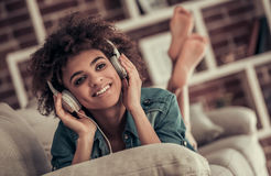 Beautiful Afro American girl at home Stock Photography