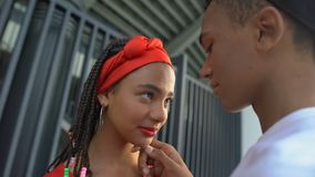 Beautiful afro-american teen couple attempting to kiss, romantic feelings. Stock footage stock video