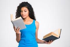 Beautiful afro american woman holding two books Stock Photo