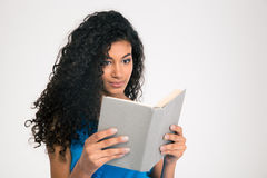 Beautiful afro american woman reading book Stock Photo