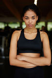 Beautiful afro-american woman with a slender figure spends time in the fitness center Stock Photo