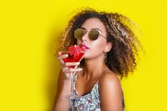 Beautiful Afro American Woman With Pink Cocktail At A Party In Summer. Stock Photos