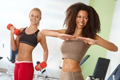 Beautiful afro girl exercising at the gym. Smiling Stock Photo