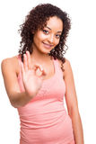 Beautiful afro woman doing OK sign Royalty Free Stock Images