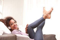 Beautiful afroamerican woman on a sofa Royalty Free Stock Photography