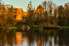 Beautiful afternoon light in park with old castle ruins Stock Photo