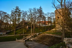 Beautiful afternoon light in park with old castle ruins. Beautiful afternoon light in public park with green grass and old castle ruins. Shot in Cesis, Latvia Royalty Free Stock Image